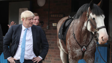 Why the long face? British Prime Minister Boris Johnson visited a police academy on Thursday.