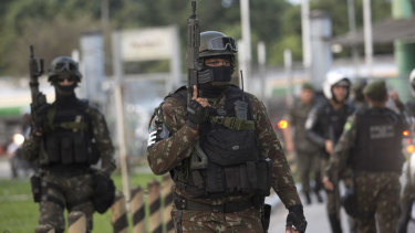 Soldiers guard an oil refinery in Duque de Caxias, Brazil.