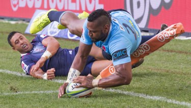 Sorely missed: Taqele Naiyaravoro scores for NSW against the Rebels last year.