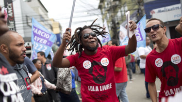 Supporters of Workers' Party candidate for vice-president Fernando Haddad shout slogans during a campaign rally in Rio.