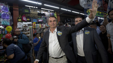 National Social Liberal Party presidential candidate Jair Bolsonaro greets people in Rio de Janeiro.