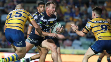 Scott Bolton of the Cowboys takes it up against the Parramatta Eels at 1300SMILES Stadium in  Townsville on Saturday.