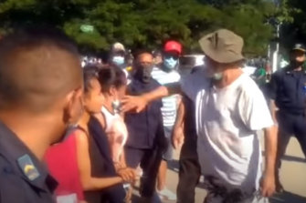 ormer East Timorese president and prime minister Xanana Gusmao slaps a mourner at least three times outside a COVID isolation facility in Dili yesterday.