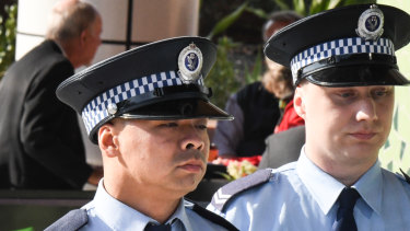 Senior Constable Frederick Tse (left) and Senior Constable Jakob Harrison arrive at the Coroner's Court in Lidcombe on Tuesday.