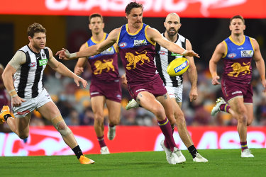 Joe Daniher gets a kick away for the Brisbane Lions against Collingwood at the Gabba in round 22.
