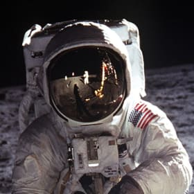 Buzz Aldrin's helmet cover reflects Apollo 11 commander Neil Armstrong taking his picture on the lunar surface in July 1969.