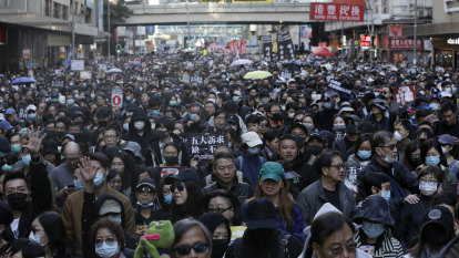 'We must not give up': Thousands march for democracy in Hong Kong