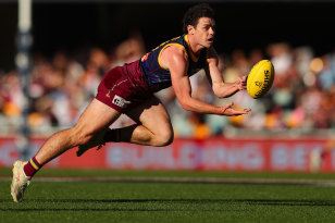Lending a hand: Brisbane's Brownlow Medal favourite Lachie Neale in action against the Saints at The Gabba on August 23.