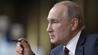 Russian President Vladimir Putin attends his annual news conference in Moscow.