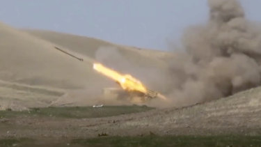 An Azerbaijan rocket launches from a missile system at the contact line of the self-proclaimed Republic of Nagorno-Karabakh, Azerbaijan.