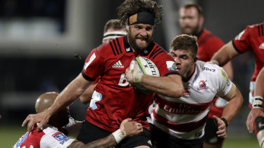 Hair-raising: Heiden Bedwell-Curtis runs at the Lions defence.