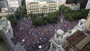 People protest against leading presidential candidate Jair Bolsonaro, at Cinelandia Square in Rio de Janeiro on Saturday.