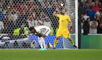 Marcus Rashford took England's third penalty and hit the post