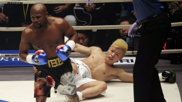 Over and out: Floyd Mayweather proved far too strong for Japanese kickboxer Tenshin Nasukawa.