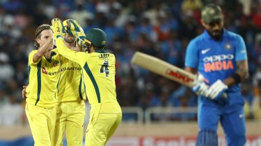 Adam Zampa celebrates his wicket of Virat Kohli during a game in India in 2019.