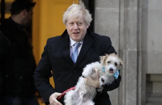 Like Donald Trump, Boris Johnson can be taken neither literally nor seriously ... the Prime Minister with his dog, Dilyn, after he voted in the general election in Westminster.