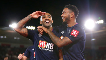 Callum Wilson (left) celebrates after sealing the points against Southampton.