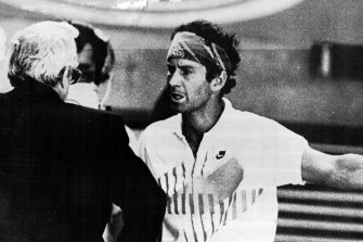 McEnroe argues with tournament director Ken Farrar.