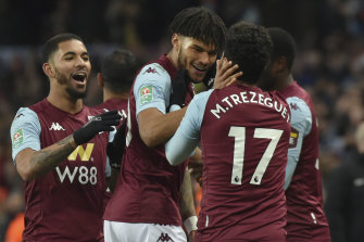 Trezeguet is congratulated by Tyrone Mings and Douglas Luiz after his stoppage-time goal sent Villa to the final.