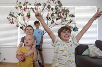 "Jessica Beaton's sons, George, 8, Hamish, 6, Louis, 4, Jude, 18 months, play by the ""Christmas branch""."