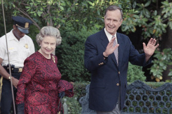 George H.W. Bush escorts the Queen from the White House to a helicopter en route to Baltimore to watch her first major league baseball game.