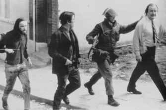 Civil rights protester Hugh Logue and MPs John Hume and Ivor Cooper are marched away by British troops after a peaceful protest in Londonderry in August 1971.