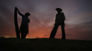 Cowboys talk at dawn in Corumba, in the Pantanal wetlands of Brazil. As of November 6, fires have ripped through the biodiverse region, consuming 15,000 football fields of vegetation in just 10 days, burning some animals alive.