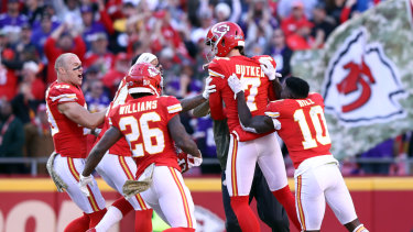 Harrison Butker (No.7) is mobbed by teammates after his game-winning field goal for Kansas City.