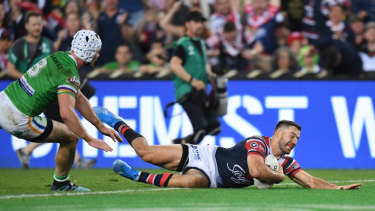Killer blow: James Tedesco goes over for the premiership-winning try.