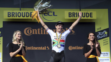 Success: Daryl Impey celebrates on the podium after winning the ninth stage of the Tour de France.