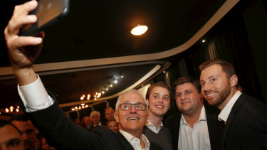 Punters grab a selfie with the Prime Minister at the Seaford Hotel on Tuesday night.