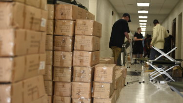 Volunteers assemble cots in an American Red Cross shelter in a Charleston, South Carolina.