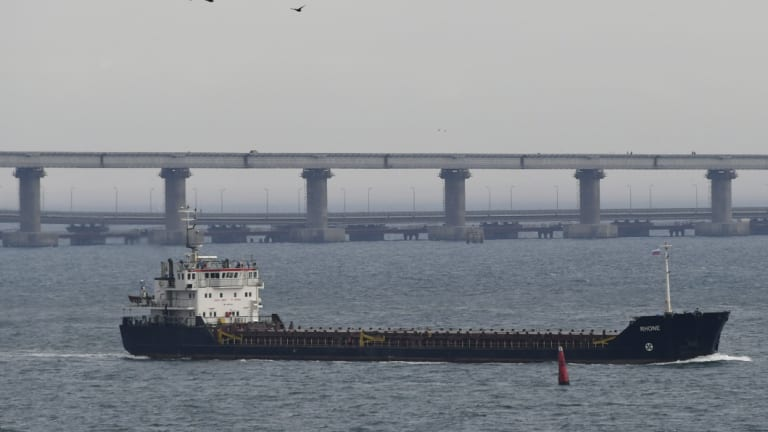 A ship travels near the Kerch bridge on Monday as the Ukraine implemented martial law following an incident with Russia in the Kerch Strait.