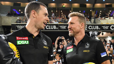 Tactical triumph: Nick Maxwell and Collingwood coach Nathan Buckley after the round 5 win over Brisbane in front of a sellout crowd at the Gabba.
