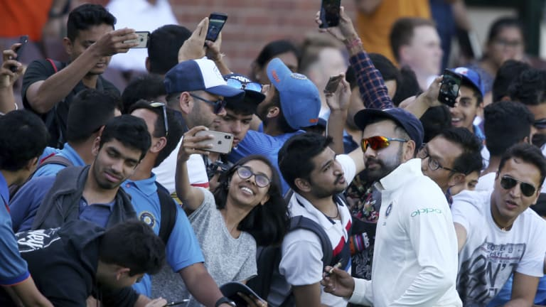 Star power: Rohit Sharma meets fans during a break in the tour match in Sydney.