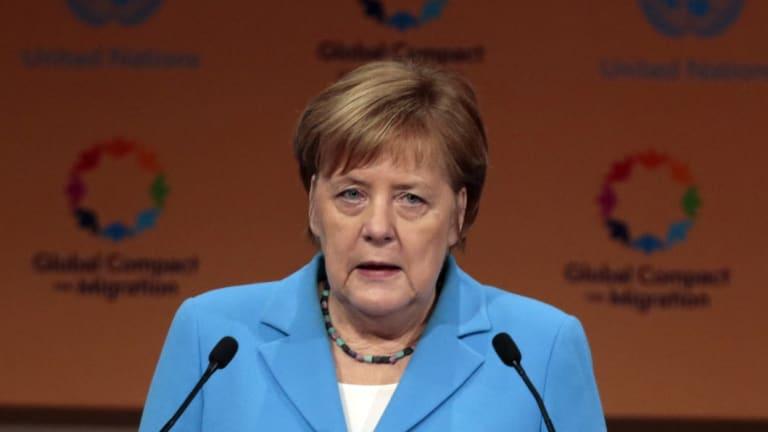 German Chancellor Angela Merkel addresses delegates in Morocco.
