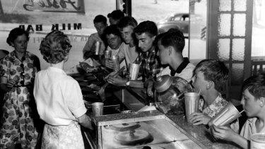 Thirsty boys knockback a shake at an Australian milk bar in 1968.