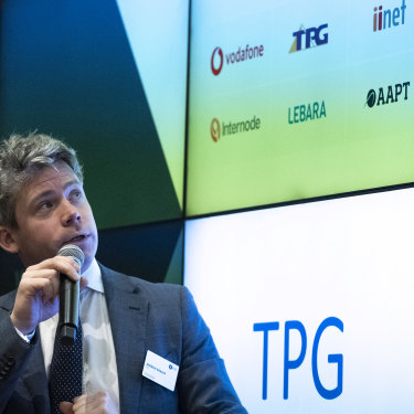 ASX Senior Manager Andrew Weaver launching the combined Vodafone TPG as a new listing on the stock exchange.