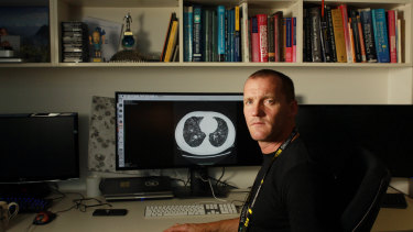 Professor Stuart Grieve, with a lung CT scan showing moderate COVID-19. He's the co-creator of a tool that will train doctors in diagnosing the disease from scans.