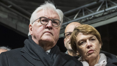 German President Frank-Walter Steinmeier and his wife Elke Buedenbender attend a vigil for the victims near the Midnight shisha bar, one of the sites of the shootings.