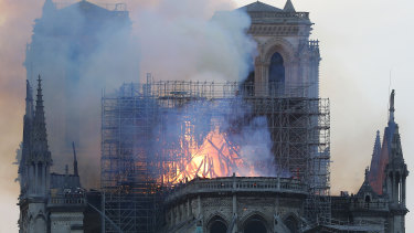 Flames and smoke rise from Notre-Dame Cathedral as it burns in Paris.