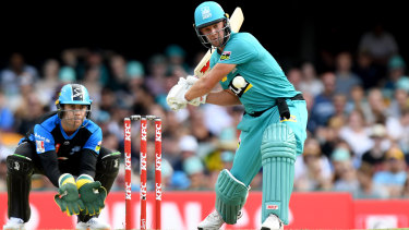 AB de Villiers of the Heat shapes up to hit a four against the Adelaide Strikers at the Gabba on Tuesday.
