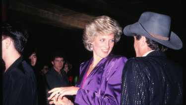 Princess Diana and Molly Meldrum attend a charity rock concert at the Melbourne Concert Hall.