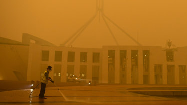 Parliament House in Canberra shrouded in eerie smoke.