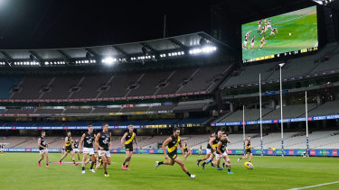 The sound and the fury: Richmond and Carlton in action at an empty MCG.