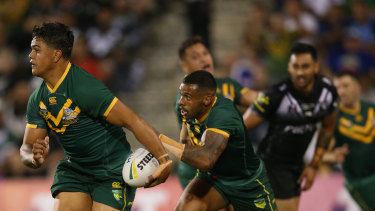 In green and gold: Latrell Mitchell on the fly for Australia in Wollongong against New Zealand.