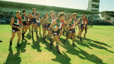 Ben Allan leads the Dockers onto East Fremantle Oval for their first match against an AFL side, Essendon.