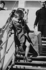 Six-year-old Bruno Cielli from Italy carries his suitcase ashore at North Wharf in Docklands in 1965.