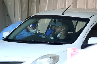 A man is tested at a drive-through clinic in Brisbane after Queensland Premier Annastacia Palaszczuk announced a snap three-day lockdown.