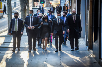 Matthew Guy (second from right) walks to the Liberal party room on Tuesday, flanked by his supporters, to topple Michael O'Brien.